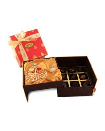 Layered Rakhi Box with 9 assorted chocolates, Silver coated plate with gold coated bowls for Kumkum and akshaj and Silver coated bracelet Rakhi