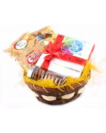 Superb Holi basket with chocolates, cookies & Herbal gulaal colour